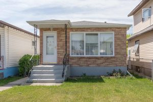 Solid & Straight 2 Bedroom Bungalow with Detached Garage and Deep Lot